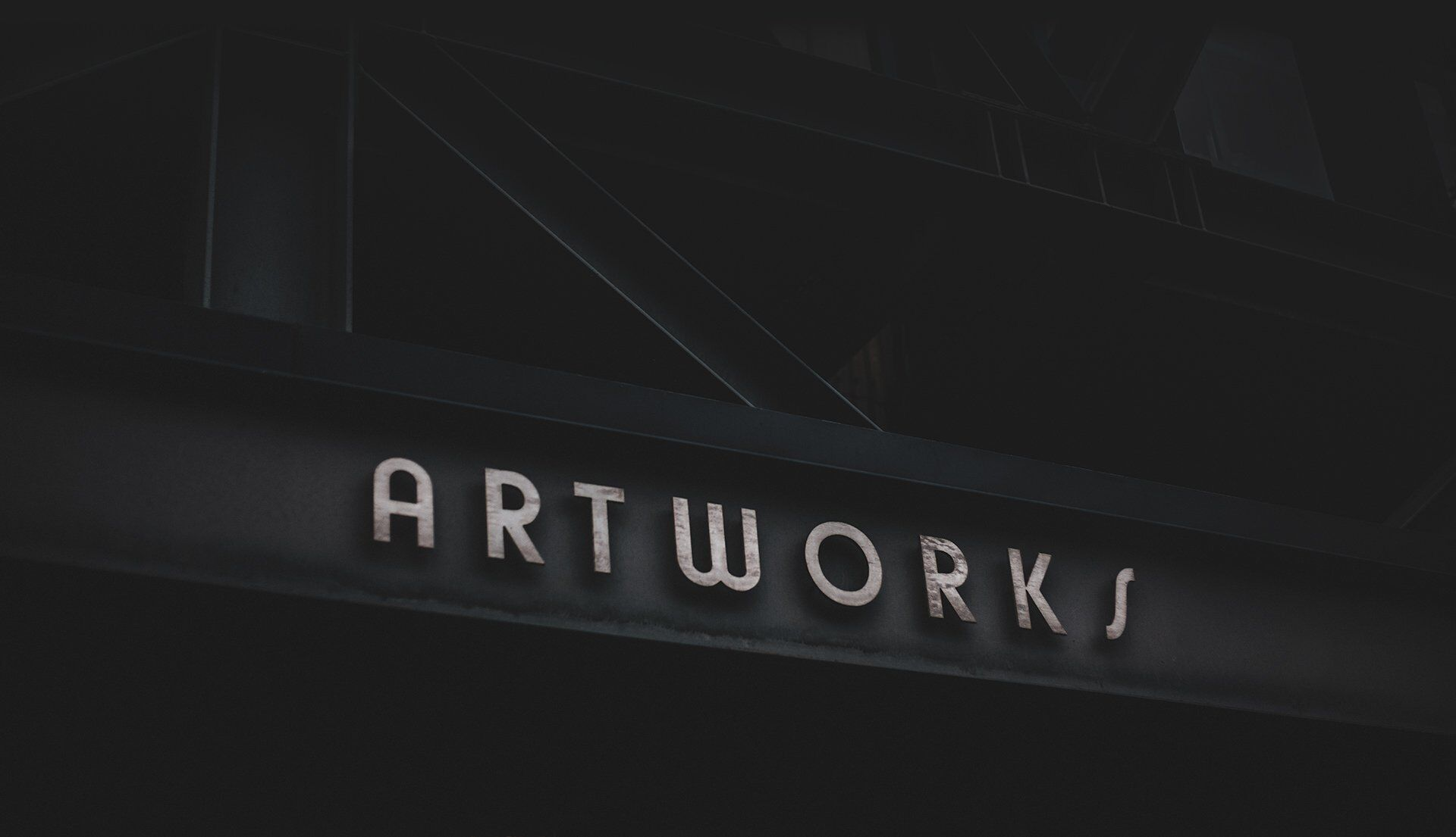 A moody photo of a building with the name Artworks.