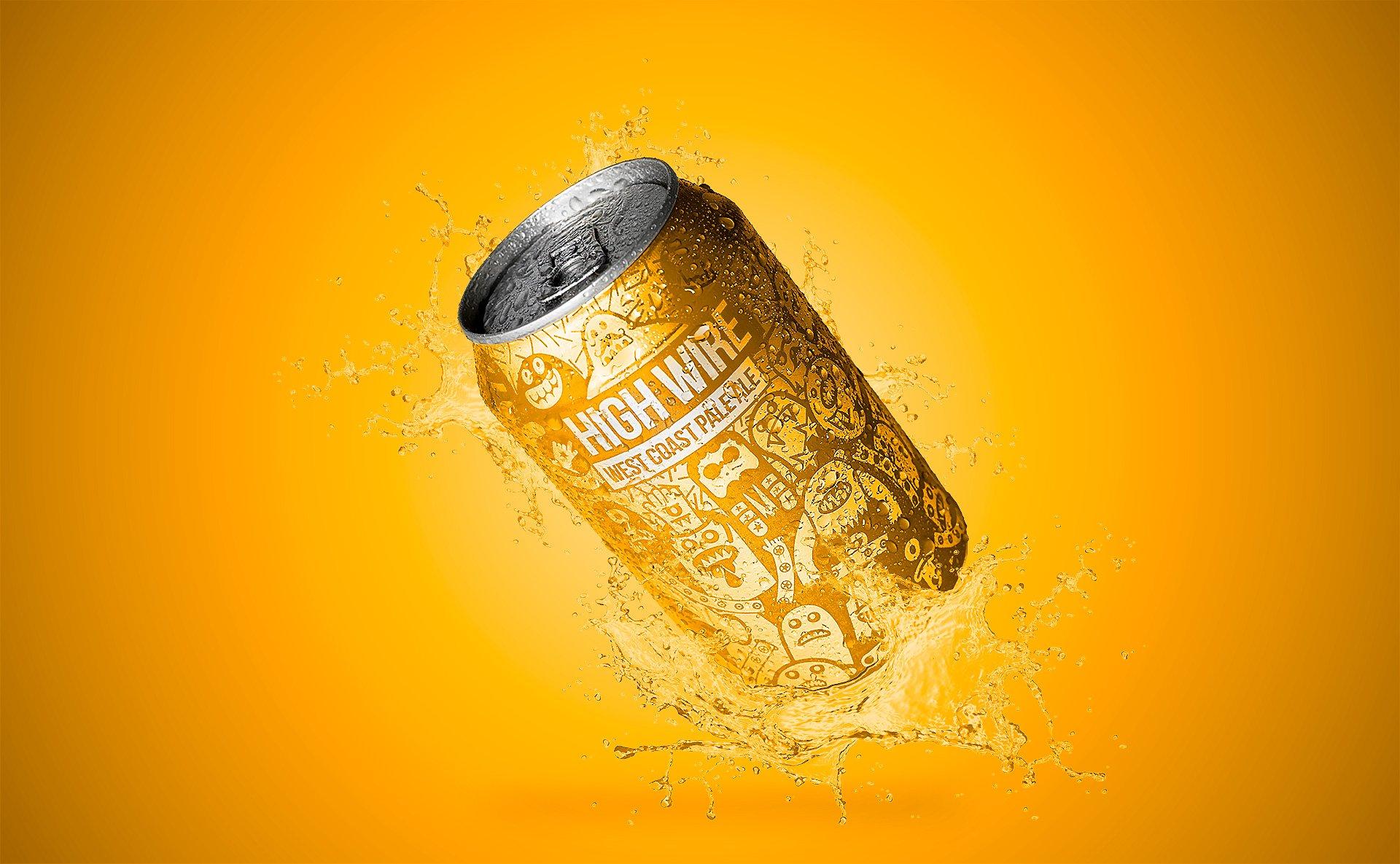 A craft beer can splashing.
